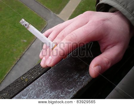 Hand with smoking cigarette