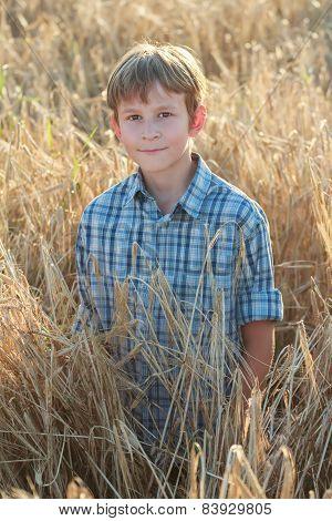 Teenage Farmer Standing Among Barley Field