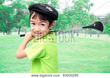Little Boy Taking Golf Club At Golf Course Background