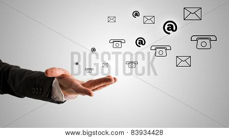 Open Businessman Hand With At, Telephone And Mail Symbols