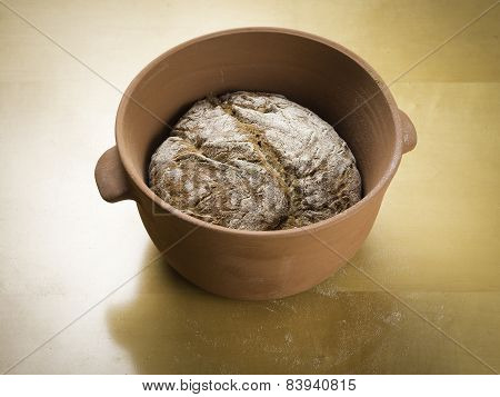 Rye Loaf Of Bread Baked In A Clay Baking Bowl