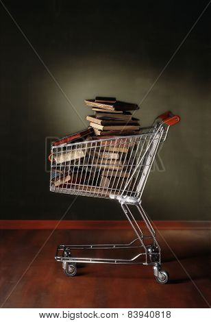 Photography Of Shopping Trolley Full Of Books