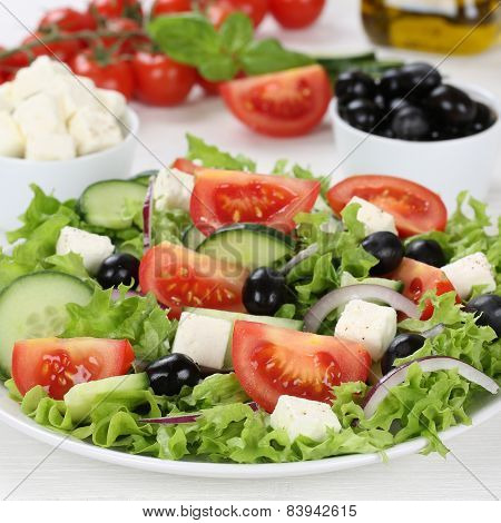 Greek Salad In Bowl With Ingredients Like Tomatoes, Feta Cheese And Olives