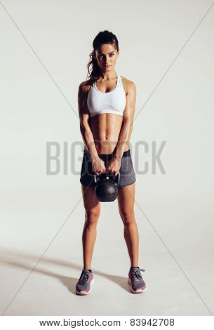 Fitness Woman Doing Crossfit Exercising With Kettle Bell