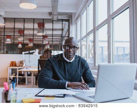 African Businessman Working In Modern Office