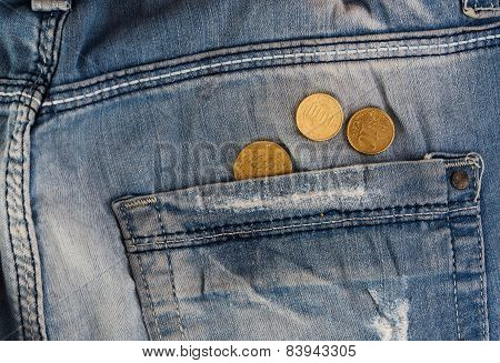 Old jeans with coins in pocket
