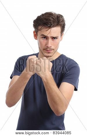 Casual Young Man Ready To Fight Attacking With Fist Up