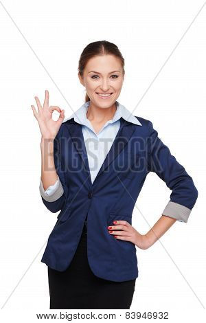 Smiling business woman showing ok sign
