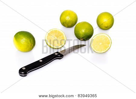 Knife and green fresh limes