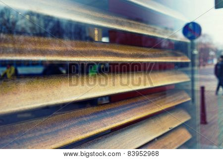 The City Is Reflected In The Window Of A Cafe With Shutters