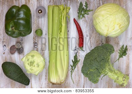 Set of vegetables on white painted wooden background.