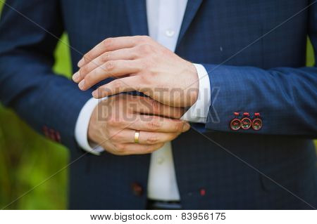 hands of young man over green background