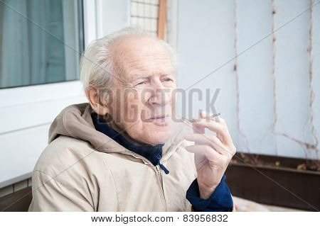 Old Man Exhaling Smoke