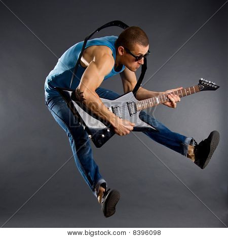 Guitar Player Jumps