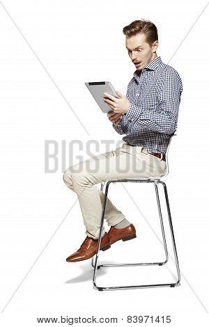 Surprised Man Looking At Tablet
