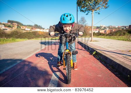 Naughty boy with defiant gesture over his bike