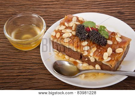 Toffee Nut Cakes On A Plate With Honey