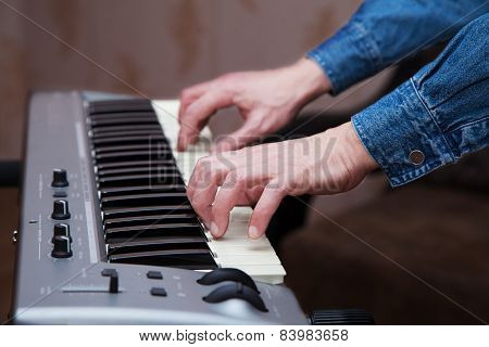 Hands Of The Musician On The Keyboard Synthesizer Closeup