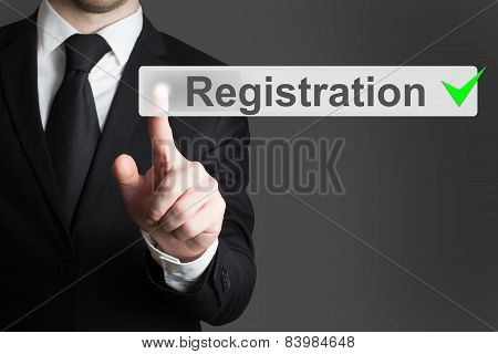 Businessman Pressing Button Registration