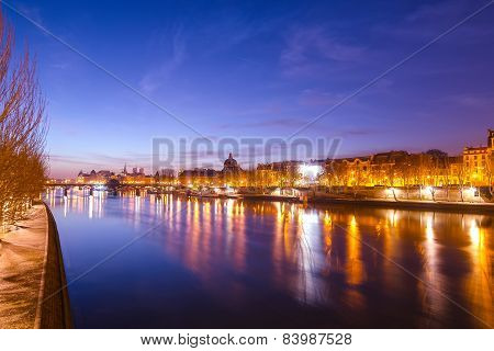 Seine river and Old Town of Paris in the sunrise