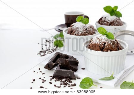 Chocolate Muffins In White Ramekins With Leaves Of Mint