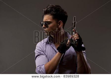 Shooter With Gun Looking Right On Grey Background
