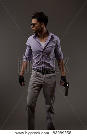 Male Shooter With Gun On Grey Background