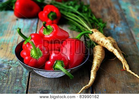 Red Pepper And Parsley Root On A Wooden Background.selective Focus