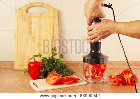 Hands chefs are going to shred red pepper in blender