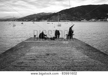 Fishermen, ligurian seashore. Black and white photo