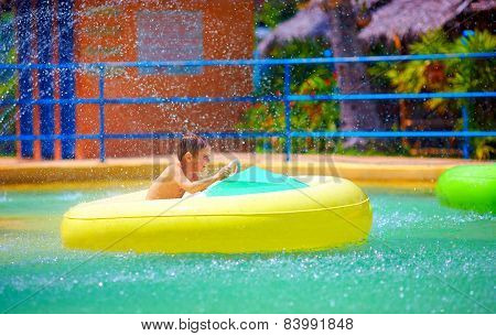 Happy Kid Driving Toy Water Boat In Aqua Park