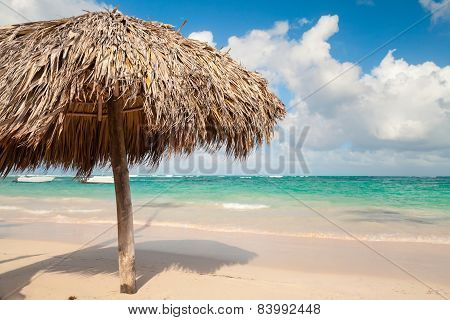 Wooden Umbrella On Beach In Dominican Republic