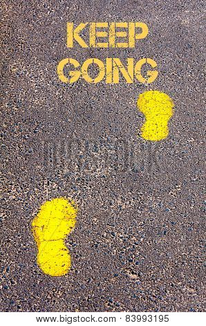 Yellow Footsteps On Sidewalk Towards Keep Going Message