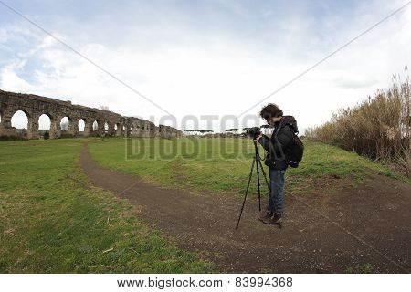 Photographer At Roman Ruins