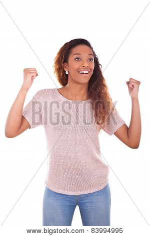 Successful African American Woman With Clenched Fist Expressing Her Joy
