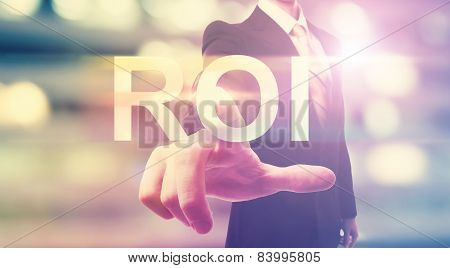 Businessman Pointing At Roi (return On Investment)