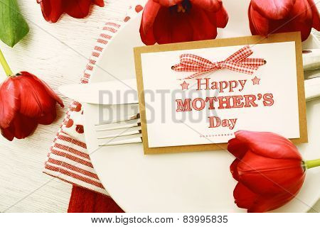 Dinner Table Setting With Mothers Day Message Card And Tulips