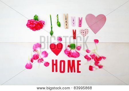 Home Text With Clothespins And Carnations