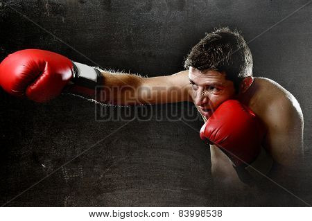 Furious Man Training Boxing On Gym With Red Fighting Gloves Throwing Vicious Punch