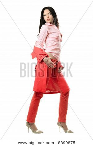 Playful Young Brunette In Red Suit. Isolated