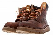 stock photo of work boots  - Old work boots in front of white background - JPG