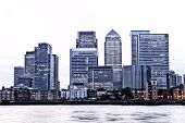 image of canary  - London Canary Wharf financial district at twilight with sky faded to white - JPG