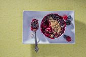 picture of serving tray  - Ramekin filled berry cobbler on a white serving tray - JPG