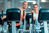 stock photo of elliptical  - Mother and daughter training - JPG