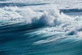 image of breaker  - Frozen motion of large wave or breaker approaching shore and short shutter speed freezing the water into droplets - JPG