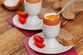 picture of baguette  - Soft boiled egg with baguette on wood table