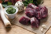 stock photo of veal meat  - ingredients for the preparation of meat broth with veal and different vegetables - JPG