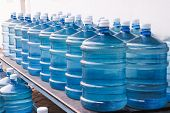 foto of plastic bottle  - Rows of Big Bottle of Drinking Water Supply - JPG