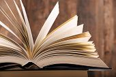 stock photo of hardcover book  - Composition with hardcover book in the library - JPG