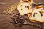 image of home-made bread  - slice of home made raisin bread with died raisin - JPG